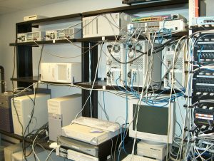 A tangle of computers and monitors on racking